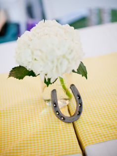 I didn't consider a bit of color down the center of the table...teal gingham would look so nice.  What do you think, Tiffany?