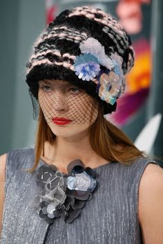 No crochet at the Chanel Spring 2015 Couture show, but I'd be remiss if I didn't point out that more than half the looks feature these blinged-out slouchy knit beanies -- bulky yarn bedecked with plastic flowers, ostrich feathers, sequins, and more. If you're looking for haute couture that you can DIY, you've found it!