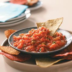 Mexican Salsa Recipe -In the summertime, I love to make this zippy salsa with fresh tomatoes from my garden instead of the canned. I even have a special pan for roasting the peppers. —Roger Stenman, Batavia, Illinois