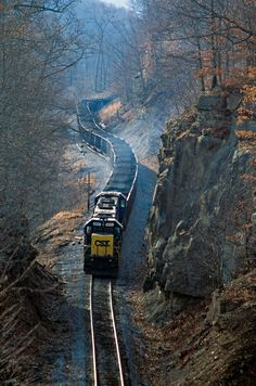 West Virginia Railroads. Two SD60s lead a unit coal train upgrade near Frenchton, West Virginia, and through a large rock cut. Photo by melvinnicholson. Source Flickr.com
