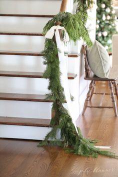 beautiful Christmas decorations   garland draped on banister