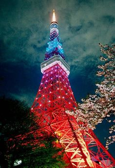 Tokyo Tower  is a communications and observation tower located in Shiba Park, Minato, Tokyo, Japan. At 333 metres (1,093 ft), it is the second-tallest artificial structure in Japan. The structure is an Eiffel Tower-inspired lattice tower that is painted white and international orange to comply with air safety regulations.  It was built in 1958.