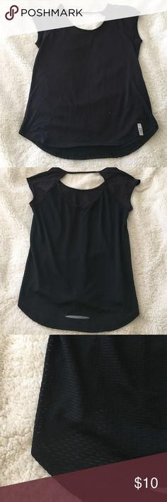 Under Armour size S Super cute black work out shirt never been worn super cute back detailing Under Armour Tops Tees - Short Sleeve