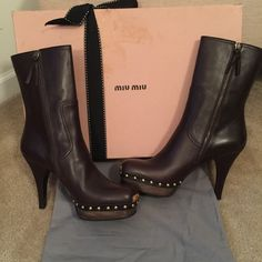 "✂️PRICE-CUT✂️ MIU MIU STUDDED BOOTS  You are looking a perfect pair of ""MIU MIU"" by ""PRADA"" brown calf height leather studded boots.  Wood platform is approximately an inch and the heel approximately 3.5 inches.  Padded on the inside providing comfort.  Side zipper.  Never worn.  Comes with box and dust bag.  100% authentic!! Miu Miu Shoes Heeled Boots"
