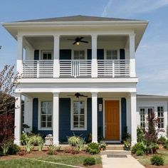 Blue exterior with white columns and double porches.