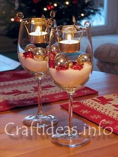 tea light inserts (if available in your area) - tea lights - fake snow powder - silver glass baubles - red glass stars - 2 large wine glasses