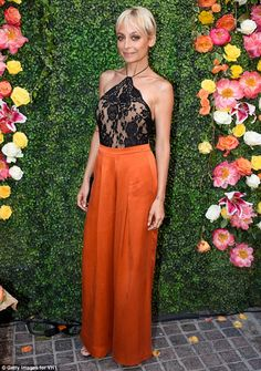 Sheer delight: Nicole Richie looked stunning in a black lace halter top with sheer panels, and a pair of bright orange trousers