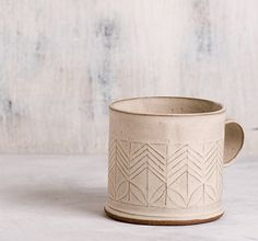 this elegant coffee cups will make your mornings brighter!  SET OF TWO- READY TO SHIP  White coffee mug in a great size for coffee lovers, adorned with geometric pattern in modern design. This modern hand build tea cup is just at the right size for your evening herbal tea. Perfect for a cozy snuggle on the couch or in bed with espresso or hot chocolate. Made of folded clay sheets stamped with geometric pattern. Dipped in White matt glaze, burned to high temperature.  > 3 tall. 3 diameter…