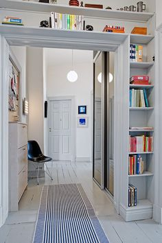 Love the way this bookcase wraps around the door. I wish my ceilings were high enough in my lounge room to do this. I have space for one shelf only. via alvhem makleri