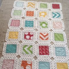 Kaffe fusion crib blanket! Using charm squares, simple sewing and crochet and this tutorial.