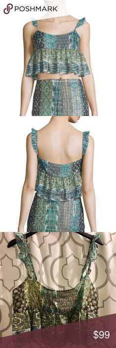 """Rachel Zoe Metallic Boho Crop Top Rachel Zoe """"Shana"""" striped-print cotton-blend tank. Round neckline. Sleeveless; ruffle shoulders. Cropped, peplum hem. Pullover style. Cotton/silk/metallic. NWT.  Size 6 - 17"""" across Size 12 - 18.5"""" across  On here to declutter, 🚫 trades. If I want something in your closet badly enough, I'll buy it 😍 Reasonable offers always welcome! Rachel Zoe Tops Crop Tops"""