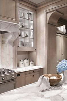 Design Galleria: Stunning ash gray recessed panel wood cabinets with marble countertops and range ...