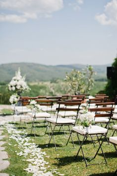 Flowers hanging on the chairs & petals to line the aisle - Image by Dominique Bader - Annasul Y Tulle Gown For A Classic White Wedding In Italy At Casa Cornacchi With Images From Dominique Bader