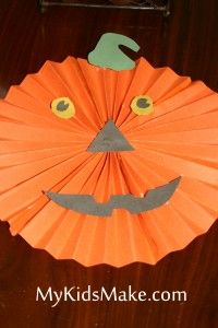 Pumpkin craft - accordion fold (horizontally) 3 pieces of orange construction paper. Fold each piece in half, making a V shape.  Glue all the pieces together to make a circle. While the orange circle is drying, trace the eyes, mouth and stem and cut them out.