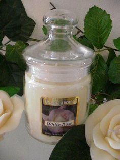 9.5 oz Apothecary Jar White Rose Scent Candle by Unique Aromas. $20.78. White Rose scent. Candle color may vary from photograph. Price per jar candle. This candle is sure to bring joy and warmth to all those in the presence of it.Some assembly may be required. Please see product details.Some assembly may be required. Please see product details.