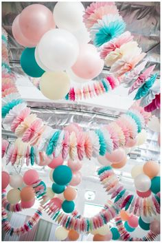 love these easter colours and the huge paper fan garlands...WOW