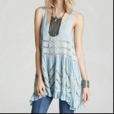 Free people voile and lace trapeze slip Original sky / baby blue color. Sold out and hard to find. Selling for less on other sites but can't lower on here because of the fees. White lace and polka dots. Sz medium. Gently used. Selling a couple other trapeze slips so check out my other listings. No trades Free People Dresses Mini
