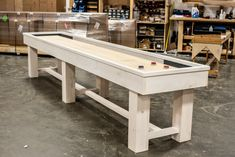 The Ponderosa Shuffleboard Table in Pine with a white wash finish shown in 12 foot size available from 9 foot to 22 foot sizes Made In America Handcrafted in Michigan