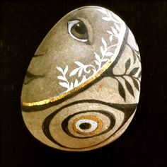 neat rock painting by Olga Sugden