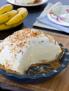 Fluffy Banana Cream Pie Recipe | ASpicyPerspective.com - This fluffy banana cream pie recipe is piled high with fresh ripe bananas and creamy vanilla filling, then topped with pillowy whipped cream and toasted coconut.