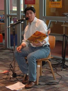 """A Seattle Public Library Día celebration hosted Jaime Mendez, a highly-respected local radio and TV personality in the Spanish-speaking community. Here he reads aloud from """"Book Fiesta"""" by Pat Mora."""""""