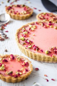 Pistachio Rose Panna Cotta Tart, with it's pistachio tart crust, rose panna cotta filling and rose jelly topping is a beautiful tart just perfect for a special occasion. via Sugar Salt Magic tarte Fancy Desserts, No Bake Desserts, Just Desserts, Delicious Desserts, Dessert Recipes, Yummy Food, Gourmet Desserts, Gourmet Foods, Healthy Food
