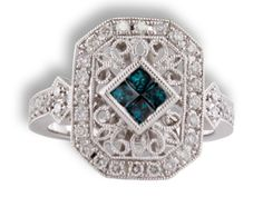 Rego #11553-01 14 karat white gold ring with blue and white diamonds (7/8 carats total weight)