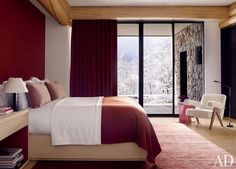 In an Aspen, Colorado, guest room, Atelier AM used the same Loro Piana cashmere for the curtains, the coverlet, and the wall covering behind the bed.