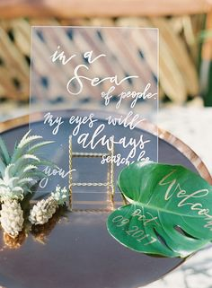 An All-White Wedding with a Chic Tropical Twist #tropicalwedding #hawaiiwedding #destinationwedding #monstera