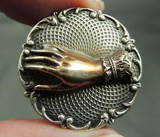 Victorian, friendship hand on silver tone metal button.