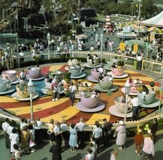 """Disneyland Pana-Vue Slide """"VP51A4 - Teacup Ride."""" Alice and pals pose for a photo at the Mad Tea Party in its original location, ca. 1959."""