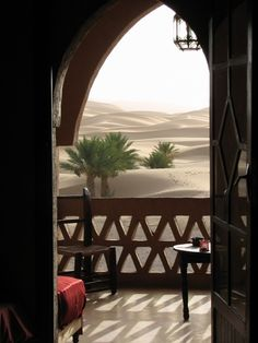 Moroccan living - love the view of the dessert