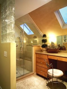 Interesting way to do a bathroom shower with slanted ceilings... (like most of the houses in my area) Found this on 20 Ways to Add Value to Your Home : Decorating : HGTV