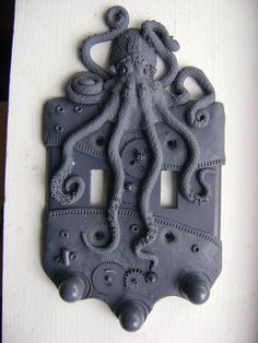 Charcoal Steampunk Octopus Light Switch Plate Wall Decor Sculpture Art Home Decor. $15.00, via Etsy.