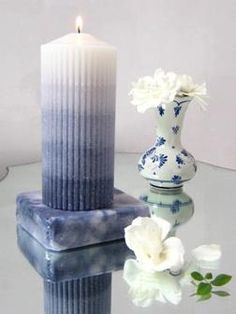 Ribbed, layered centerpiece candle molded in corrugated cardboard