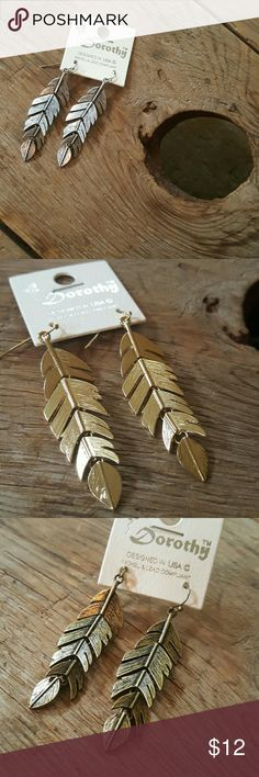 Metal feather earrings! Gold, bronze or silver metal feathers with movable joints. 2.5 in feather Would look awesome with any outfit! Jewelry Earrings