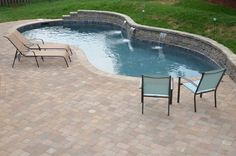 Concrete pool with sheetfalls.  Belgard pavers and coping.