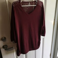 Gorgeous airy 3/4 length sleeve shirt. Maroon in color. Some pilling near arm pits, hardly noticeable. Gently loved. Whole back is lacey design with rouched sides. Simply stunning on. More like a 1x, arms seem smaller than xxl. Vanity Tops Tees - Long Sleeve