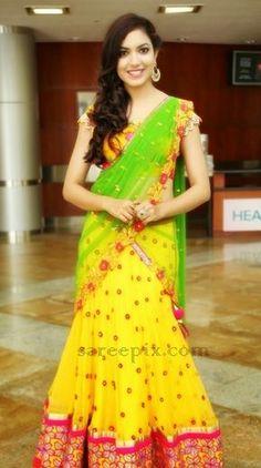 Telugu heroine Ritu varma in yellow embroidery half saree at Hi Life Luxury Expo at HICC in Hyderabad. Ritu varma is cute in fancy lehenga half saree with Lehenga Saree Design, Half Saree Lehenga, Lehenga Designs, Lehenga Suit, Lehnga Dress, Pink Lehenga, Bridal Lehenga, Half Saree Designs, Blouse Designs
