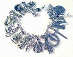 20 charms Magick Charm Bracelet on 316L stainless steel thick curb chain.   I offer this piece in three options in my shop: 8 charms at 40.00, 14 charms at 60.00 and this one includes 20 pieces.  Char