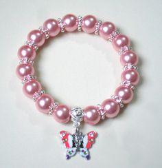 pulsera elasticada con dije mariposa en enamel de acero 316 diseño de color beads.