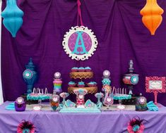 love the color scheme and decorations at this party, plum, turquoise, hot pink (though not the princessy theme).