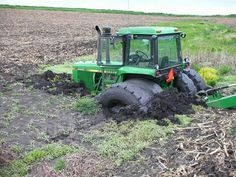 Nice JOHN DEERE 4440 Burried in the mud.