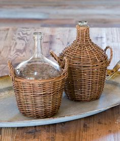 Willow Covered Wine Bottles, Wicker Covered Wine Bottles,  Very cool....$40.00 for two plus 13 for shipping at farmhousewares.com Demijohn