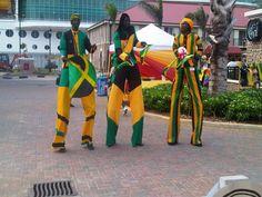 Jamaican stilt walkers stretching their legs.