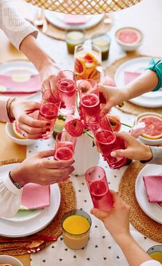 A toast among besties is what this casual gathering is all about. Tall pink glasses are a sweet festive touch. | Image: Stacey Brandford | Designer: Morgan Lindsay | #StyleAtHome #Entertaining #HolidayHome #Christmas