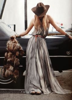Hippie Style flowy maxi dress with waist belt and cowboy hat- totally Austin texas-looking.