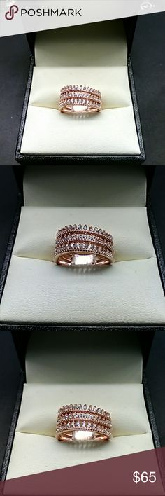 .50cts Diamonds 14k Rose Gold & Solid 925 Silver Beautiful .50 carats AAA man made white diamonds. 14k rose gold over solid 925 sterling silver. Very unique designer setting. Estate, size 7. estate 925 Jewelry Rings