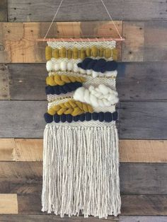 Mustard and blue wall hanging weaving