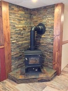 Wood Burning Stove in Rustic Family Room Wood Stove Surround, Wood Stove Hearth, Stove Fireplace, Wood Burner, Fireplace Wall, Fireplace Ideas, Rustic Fireplace Decor, Rustic Basement, Rustic Fireplaces